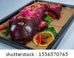 Stock photo herring fillet under beet root mash and mayonnaise coating 1556570765