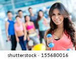 woman at the gym lifting... | Shutterstock . vector #155680016