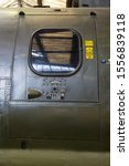 Small photo of Side door marked `jettison` on a Belvedere helicopter. Many rivets hold the metal plates together.