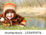 a cute little baby boy wearing... | Shutterstock . vector #155695976