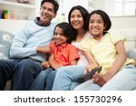 indian family sitting on sofa... | Shutterstock . vector #155730296