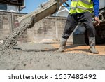 A Construction Worker Pouring A ...
