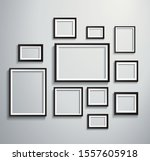 isolated picture frame on wall...   Shutterstock .eps vector #1557605918