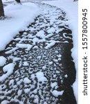 A Snow Speckled Concrete Sidwalk