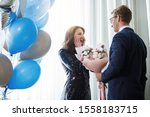 Guy Gives A Bouquet Of Flowers...