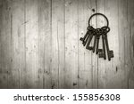 bunch of old keys on wooden... | Shutterstock . vector #155856308