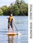 mn riding stand up paddle in... | Shutterstock . vector #155879012