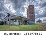 Old Abandoned Barn With Silo...