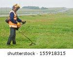 lawn mower worker man cutting... | Shutterstock . vector #155918315