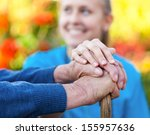 young female doctor holding his ... | Shutterstock . vector #155957636
