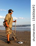 Man Metal Detecting On The...
