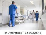 male nurse pushing stretcher... | Shutterstock . vector #156022646