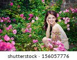 Stock photo portrait of young beautiful woman in the rose garden 156057776