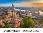 Budapest, Hungary - Beautiful golden summer sunrise with the tower of Fisherman