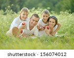 family of four is having picnic ... | Shutterstock . vector #156074012