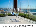 glasses of wine on a table in a ...   Shutterstock . vector #1560867392