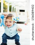 little boy with toy smiling | Shutterstock . vector #156089402