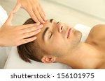 man having head massage close up | Shutterstock . vector #156101975