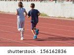 girl and boy jogging on tartan... | Shutterstock . vector #156162836