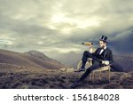 elegant man with cylinder looks ... | Shutterstock . vector #156184028