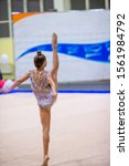 Small photo of Adorable girl with jump rope competing in rhythmic gymnastics