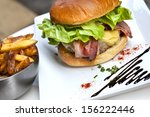 hamburger and fries on a plate | Shutterstock . vector #156222446