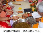 Stock photo indian hindu couple giving their offering to the sacred fire in the hawan priest also known as 1562352718