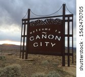 Small photo of Welcome to canon city colorado sign The prison capital also known as the balky of the dammed