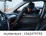 Car robber steals women's handbag, stealing - stock photo