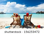 couple on a tropical beach at... | Shutterstock . vector #156253472