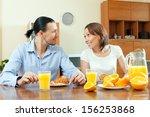 couple talking over breakfast... | Shutterstock . vector #156253868