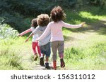 three children playing in woods ... | Shutterstock . vector #156311012