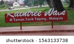 Small photo of 7th July 2019, Taiping, Perak, Malaysia - A Signage in garden that have been vandalised by some inconsiderate people.