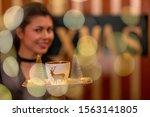 Portrait Of Waitress Carrying ...