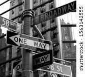 Crowded Street Sign In...