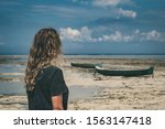 Girl With Old Boats On The...