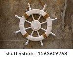 White Wooden Rudder On Stone...
