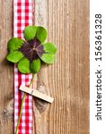 Stock photo wood background and four leaf clover 156361328