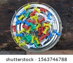 Small photo of abstraction with colored pins and needles randomly scattered ideas backgrounds.