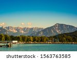 Klagenfurt, Austria 08.08.2016: Great lake Klagenfurt am Worthersee. The large lake of Klagenfurt in Austria. Many boats are anchored. Summer holiday resort. Crystal turquoise water.