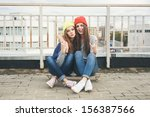 Two Young  Longboarding Girl...