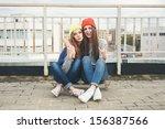 Two Young  Longboarding Girl...