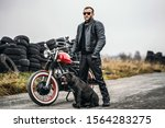Biker In A Leather Suit And Hi...