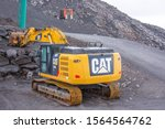Excavator Cat On A Road In The...