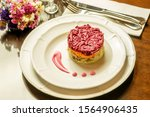 Stock photo white plate on the brown wooden table in restaurant with salad herring with vegetables potato 1564906435