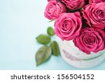 Stock photo bouquet of beautiful pink roses on light blue background 156504152