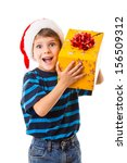 Smiling little boy in Santa's hat with yellow gift box, isolated on white - stock photo