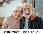 Small photo of Elderly couple. Joyful nice elderly couple smiling while being in a great mood