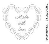heart shape made of macarons.... | Shutterstock .eps vector #1565299252