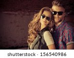 couple of young people in jeans ... | Shutterstock . vector #156540986